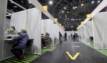 Interior view of a new coronavirus, COVID-19, vaccination center at the 'Velodrom' (velodrome-stadium) in Berlin, Germany, Wednesday, Feb. 17, 2021. (AP Photo/Michael Sohn, pool)