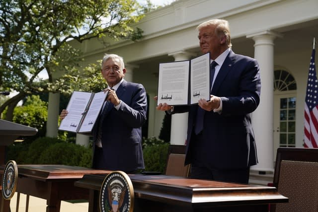President Donald Trump and Mexican President Andres Manuel Lopez Obrador pose for photos after signing a joint declaration (Evan Vucci/AP)