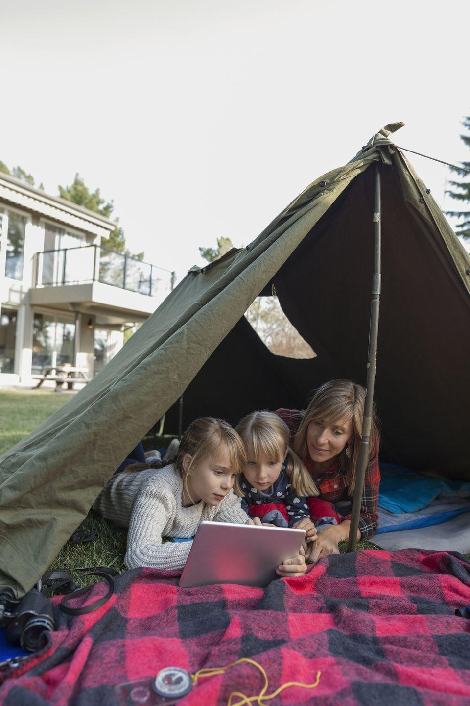 """<p>Can't make it to a real campsite this year? Try a little <a href=""""https://www.countryliving.com/entertaining/g27274046/backyard-tent-camping/"""" rel=""""nofollow noopener"""" target=""""_blank"""" data-ylk=""""slk:backyard tent camping"""" class=""""link rapid-noclick-resp"""">backyard tent camping</a> instead. Once your cookout's died down, watch fireworks from the comfort of sleeping bags and cap off the night with some (not <em>super</em> scary) ghost stories before sleeping under the stars. </p><p><a class=""""link rapid-noclick-resp"""" href=""""https://www.amazon.com/Emonia-Waterproof-Backpacking-Traveling-Lightweight/dp/B07BMSWX8M/?tag=syn-yahoo-20&ascsubtag=%5Bartid%7C10050.g.4463%5Bsrc%7Cyahoo-us"""" rel=""""nofollow noopener"""" target=""""_blank"""" data-ylk=""""slk:SHOP SLEEPING BAGS"""">SHOP SLEEPING BAGS</a></p>"""