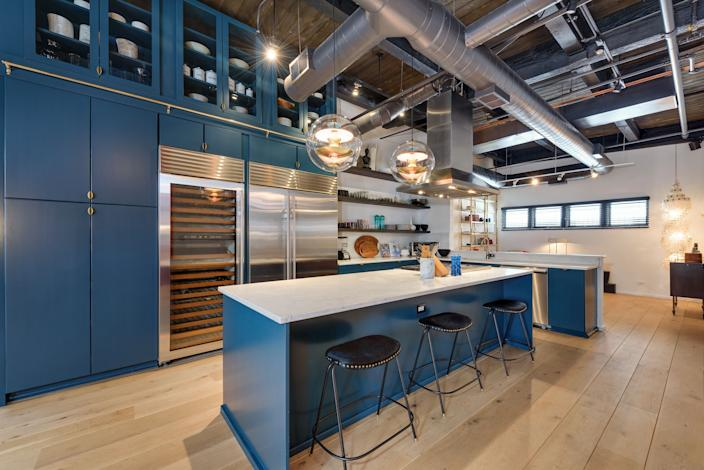 Like the rest of the unit, the kitchen has an industrial vibe.