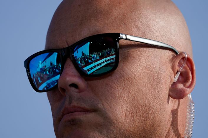 """Supporters of President Donald Trump are reflected in the glasses of a U.S. Secret Service agent during a campaign rally at Dayton International Airport, Sept. 21, 2020. <span class=""""copyright"""">Alex Brandon—AP</span>"""