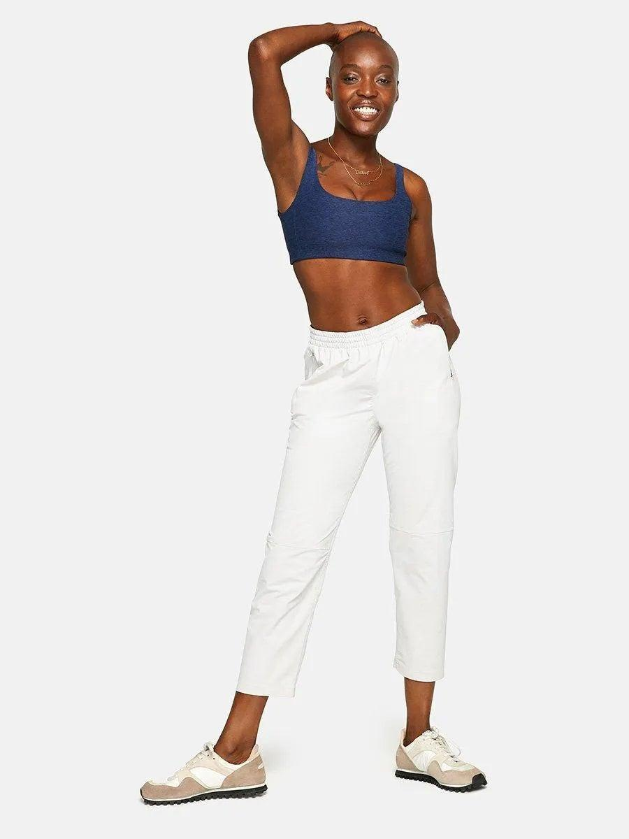 """<h2>Outdoor Voices Rectrek Pant</h2><br>If the people behind the athleisure powerhouse brand are brave enough to call this their most versatile pant, then we're game to believe them. These cropped, relaxed-fit bottoms are made with OV's special TerraStretch fabric (a fancy term for four-way stretch) and are weather resistant (so spill however many in-flight cocktails you want on them). <br><br><em>Shop <strong><a href=""""https://www.outdoorvoices.com/"""" rel=""""nofollow noopener"""" target=""""_blank"""" data-ylk=""""slk:Outdoor Voices"""" class=""""link rapid-noclick-resp"""">Outdoor Voices</a></strong></em><br><br><strong>Outdoor Voices</strong> Rectrek Pant, $, available at <a href=""""https://go.skimresources.com/?id=30283X879131&url=https%3A%2F%2Fwww.outdoorvoices.com%2Fproducts%2Fw-Rectrek-Pants%3Fvariant%3D34894684229"""" rel=""""nofollow noopener"""" target=""""_blank"""" data-ylk=""""slk:Outdoor Voices"""" class=""""link rapid-noclick-resp"""">Outdoor Voices</a>"""