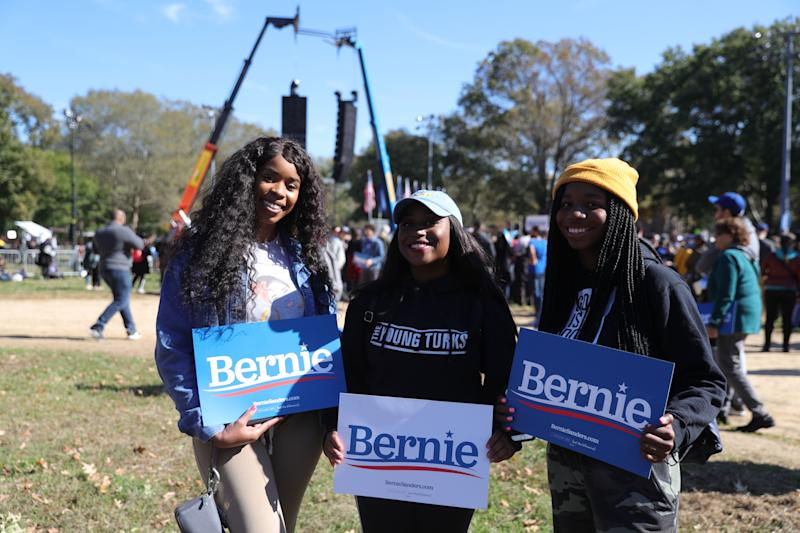 Three Sanders supporters at his Oct. 19 rally at Queensbridge Park. (Photo: Gordon Donovan/Yahoo News)
