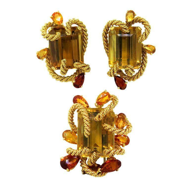 """<p><strong>David Webb</strong></p><p>1stdibs.com</p><p><a href=""""https://www.1stdibs.com/jewelry/earrings/more-earrings/rare-original-1960s-david-webb-gem-set-earrings-brooch-set/id-j_178252/"""" target=""""_blank"""">Discover</a></p><p>Created by the famed New York jeweler <a href=""""https://www.davidwebb.com"""" target=""""_blank"""">David Webb</a> during the 1960s, these citrine-centered earrings and brooch are representative of the house's forward-thinking and boundary-pushing style.  </p>"""