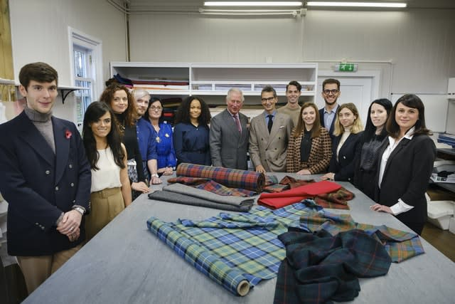 Charles with Modern Artisan students. Mike Wilkinson/PA Wire