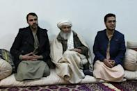 Mohammad Taher Rasheed (C), is the father of assassinated activist Mohammad Yousuf Rasheed, one of several Afghans to have been targeted in string of recent political attacks
