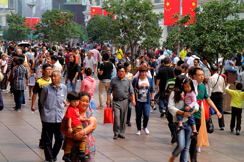 Pictured is people walking along a busy Nanjing Road in Shanghai.