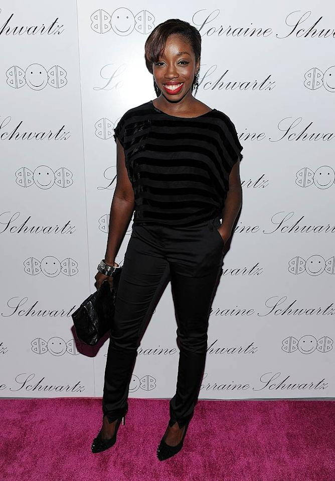 """American Boy"" singer Estelle opted for classic tailored black slacks paired with a subtle striped top at the fancy soiree that was held at Manhattan hot spot Lavo. Dimitrios Kambouris/<a href=""http://www.wireimage.com"" target=""new"">WireImage.com</a> - November 22, 2010"