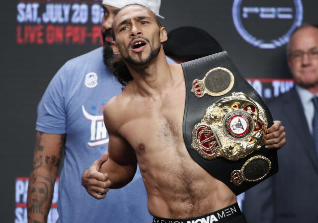 Keith Thurman holds a belt during a weigh-in Friday, July 19, 2019, in Las Vegas. Thurman is scheduled to fight Manny Pacquiao in a welterweight championship boxing match Saturday in Las Vegas. (AP Photo/John Locher)