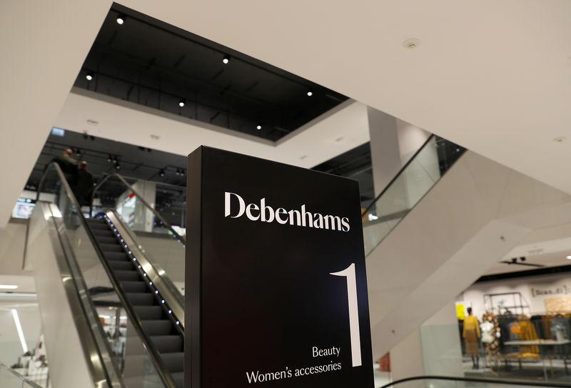 Signage is seen in a new Debenhams department store in Watford