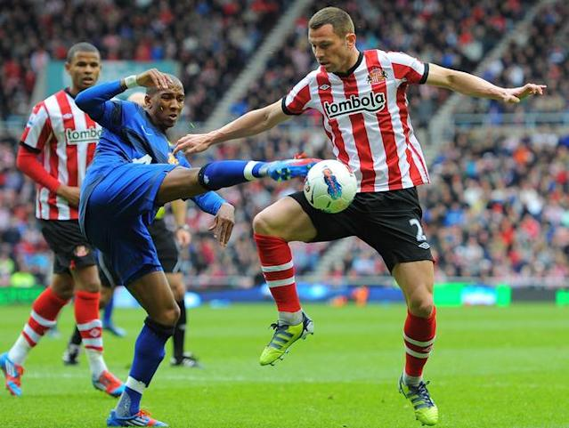 "Sunderland's English-born Scottish defender Philip Bardsley (R) vies with Manchester United's English striker Ashley Young (L) during the English Premier League football match between Sunderland and Manchester United at The Stadium of Light in Sunderland, north-east England on May 13, 2012. AFP PHOTO/ANDREW YATES RESTRICTED TO EDITORIAL USE. No use with unauthorized audio, video, data, fixture lists, club/league logos or ""live"" services. Online in-match use limited to 45 images, no video emulation. No use in betting, games or single club/league/player publications.ANDREW YATES/AFP/GettyImages"