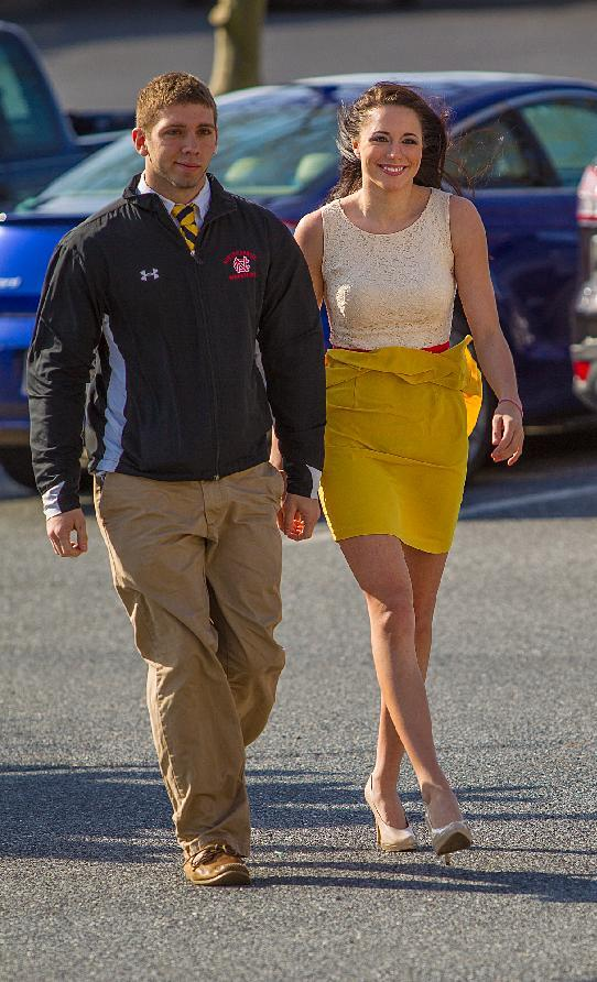 Melissa King, right, and boyfriend David Stour arrive at the Ocean City, Md., Courthouse Monday April 22, 2013. King who resigned as Miss Delaware Teen USA after an online porn video surfaced was given a year of probation Monday for underage alcohol possession in Maryland. (AP Photo/The Wilmington News-Journal, ) NO SALES THE NEWS JOURNAL/ROBERT CRAIG