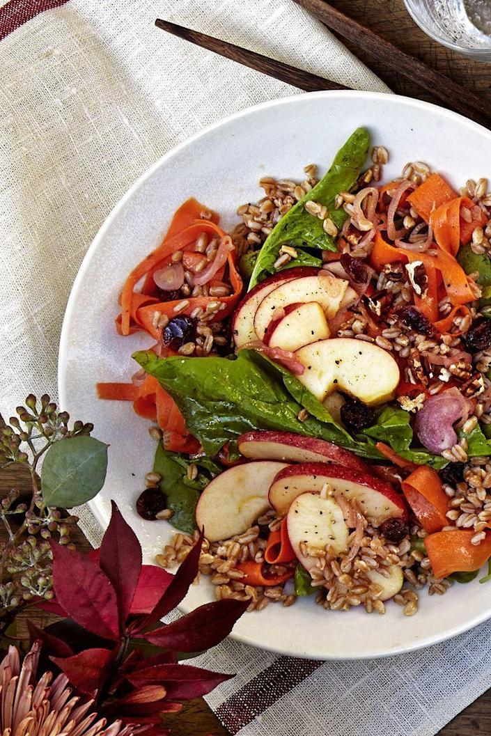 "<p>Farro isn't a super common ingredient, but after trying this salad, you'll always want to keep some in your pantry. Packed with crisp apples, zesty arugula, and sweet dried cranberries, you'll definitely be able to fill yourself up on this hearty salad.</p><p><a href=""https://www.womansday.com/food-recipes/food-drinks/a23601862/farro-apple-and-carrot-salad-recipe/"" rel=""nofollow noopener"" target=""_blank"" data-ylk=""slk:Get the Farro, Apple, and Carrot Salad recipe."" class=""link rapid-noclick-resp""><em>Get the Farro, Apple, and Carrot Salad recipe.</em></a></p>"