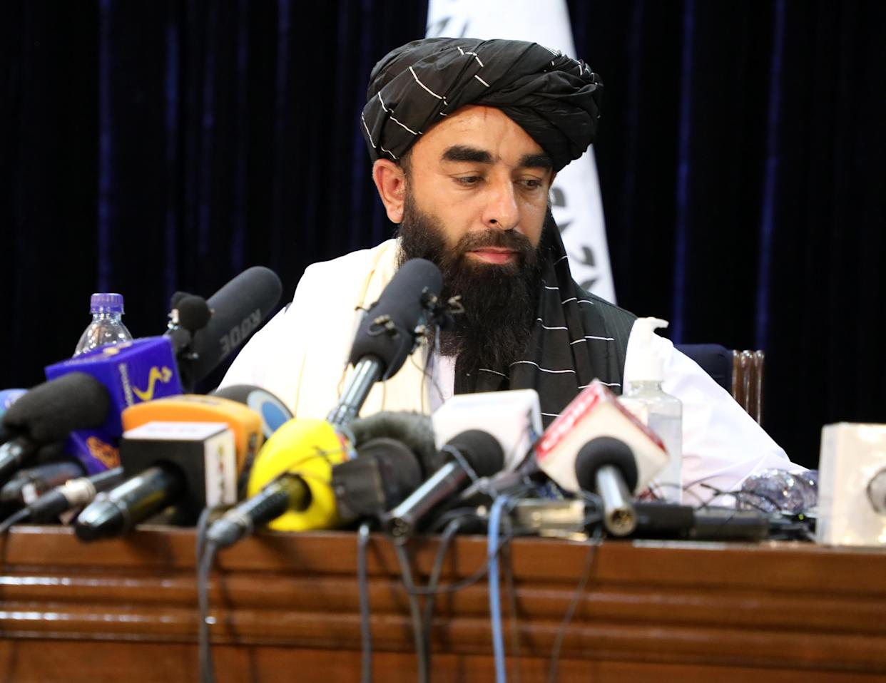 KABUL, AFGHANISTAN - AUGUST 17: Taliban spokesperson Zabihullah Mujahid answers press members questions as he holds a press conference in Kabul, Afghanistan on August 17, 2021. (Photo by Sayed Khodaiberdi Sadat/Anadolu Agency via Getty Images)