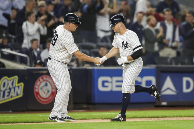 New York Yankees' Brett Gardner celebrates with third base coach Phil Nevin (88) after hitting a solo home run during the fourth inning of a baseball game against the Los Angeles Angels, Thursday, Sept. 19, 2019, in New York. (AP Photo/Mary Altaffer)