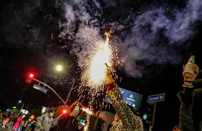 Los Angeles, CA, Saturday, November 7, 2020 - Erica Clum sets off fireworks as celebrations on Sunset Blvd. continue after Joe Biden is announced as the President-elect of the United States. (Robert Gauthier/ Los Angeles Times)