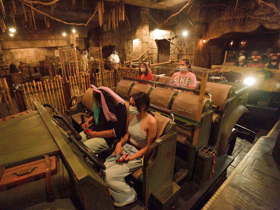This image shows an Indiana Jones ride with plastic partitions between rows.