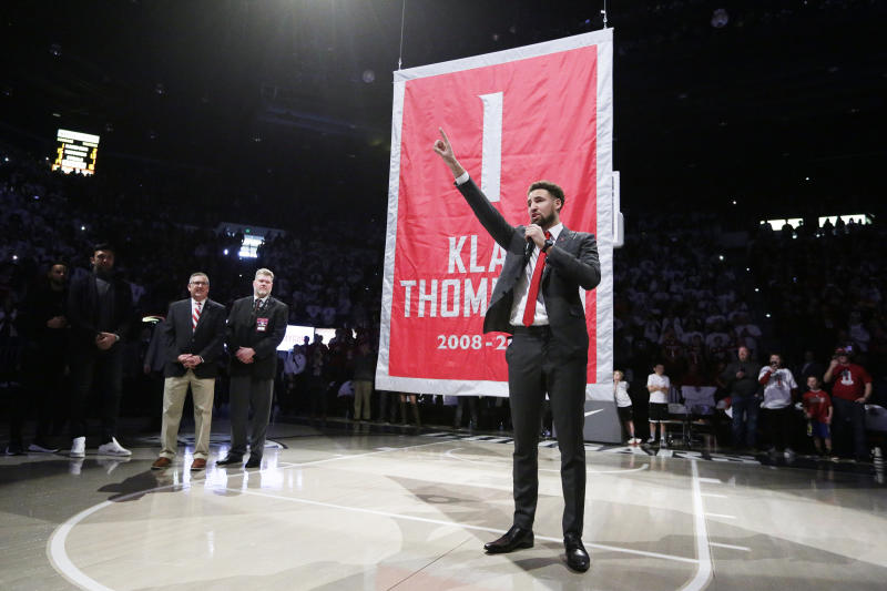 Golden State Warriors and former Washington State guard Klay Thompson speaks as the school retired his jersey number during halftime of an NCAA college basketball game between Washington State and Oregon State in Pullman, Wash., Saturday, Jan. 18, 2020. (AP Photo/Young Kwak)