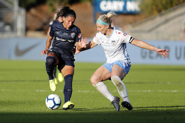 North Carolina Courage's Debinha, left, works the ball against Chicago Red Stars's Julie Ertz in the NWSL championship. Could they go to a different U.S. league? (AP Photo/Karl B DeBlaker)