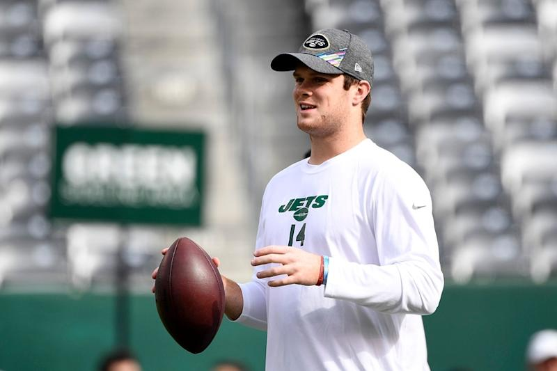 Sam Darnold holds ball during warmups