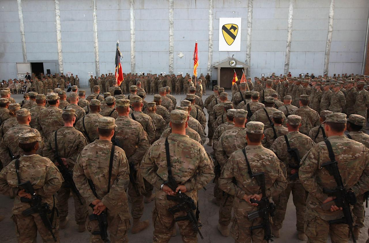 BAGRAM, AFGHANISTAN - SEPTEMBER 11:  American soldiers stand at attention during the an anniversary ceremony of the terrorist attacks on September 11, 2001 on September 11, 2011 at Bagram Air Field, Afghanistan. Ten years after the 9/11 attacks in the United States and after almost a decade war in Afghanistan, American soldiers paid their respects in a solemn observence of the tragic day.  (Photo by John Moore/Getty Images)