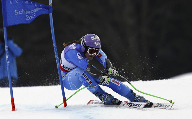 Slovenia's Tina Maze speeds down the course during the women's super-G, at the Alpine skiing world championships in Schladming, Austria, Tuesday, Feb.5, 2013. (AP Photo/Alessandro Trovati)