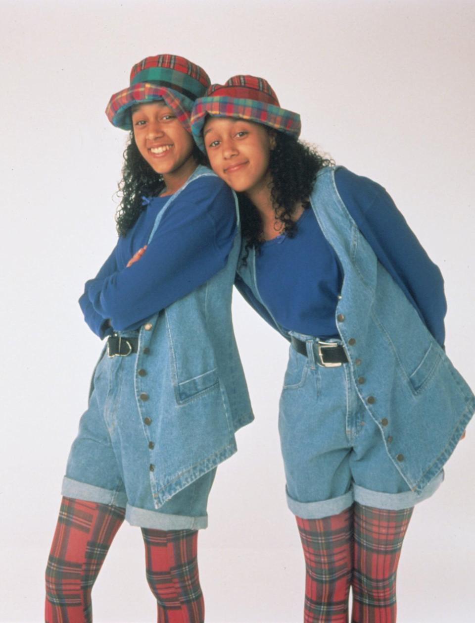 <ul> <li><strong>What to wear for Tia:</strong> A blue long-sleeved shirt, denim vest, high-waisted shorts with a belt, and plaid leggings with a matching hat.</li> <li><strong>What to wear for Tamera:</strong> Match with Tia!</li> </ul>