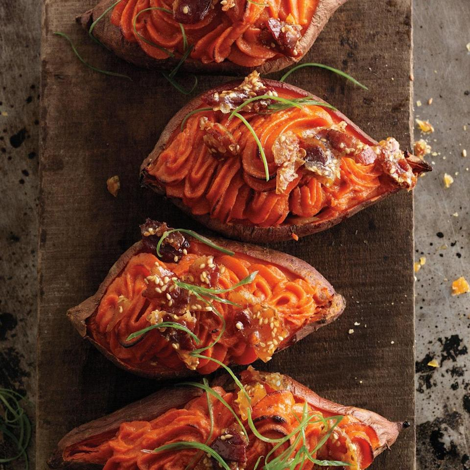 """Enriched with eggs, butter, and miso, the creamy sweet potato purée in this recipe gets a crunchy bacon-sesame topping. <a href=""""https://www.epicurious.com/recipes/food/views/twice-baked-sweet-potatoes-with-bacon-sesame-brittle-394716?mbid=synd_yahoo_rss"""" rel=""""nofollow noopener"""" target=""""_blank"""" data-ylk=""""slk:See recipe."""" class=""""link rapid-noclick-resp"""">See recipe.</a>"""