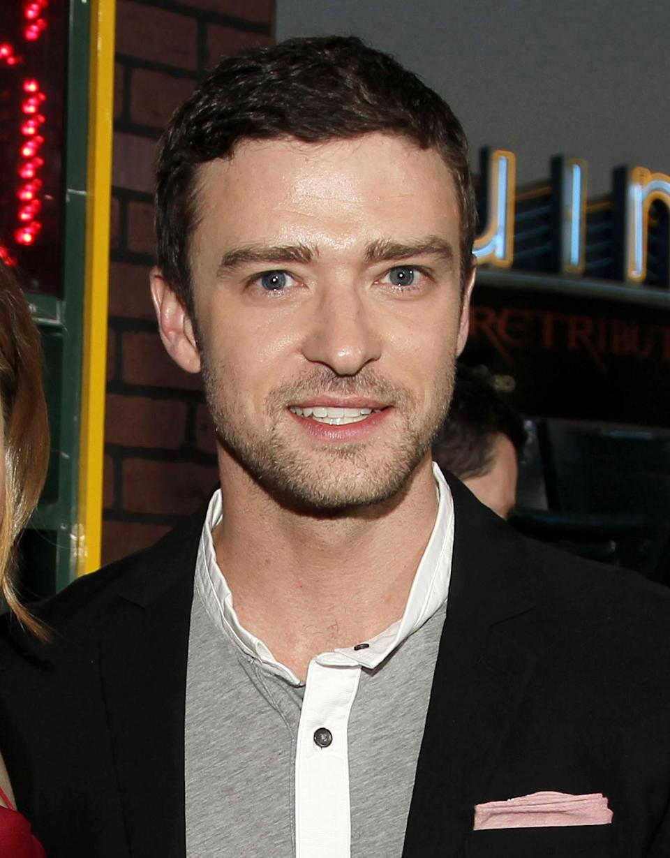 """FILE - This Sept. 19, 2012 file photo shows singer-actor Justin Timberlake at the premiere of """"Trouble With the Curve"""" in Los Angeles. Timberlake released a lyric video of his hit single, """"Suit & Tie,"""" featuring rapper Jay-Z. After the highly anticipated audio version dropped in mid-January 2013, the lyric video premiered nearly two weeks later on all of MTV's television networks and website. (Photo by Matt Sayles/Invision/AP, file)"""