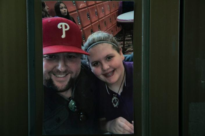 A photo of Bryan DeHart and his daughter Savanah DeHart is displayed in her room at the Mary Free Bed Rehabilitation Hospital in Grand Rapids Thursday, Jan. 23, 2020. Savanah DeHart is being treated for the debilitating effects of the Triple E (Eastern Equine Encephalitis) virus. DeHart was likely bitten by a an infected mosquito last summer and suffered stroke-like symptoms.
