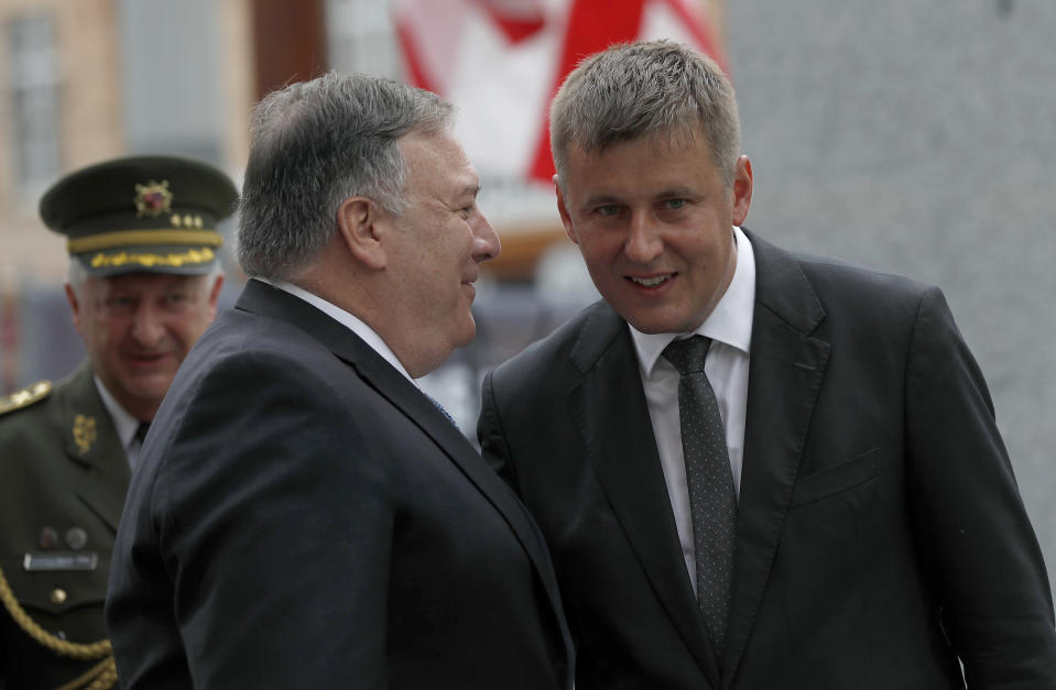 U.S. Secretary of State Mike Pompeo, front left, talks to Czech Republic's Foreign Minister Tomas Petricek, right, during a ceremony at the General Patton memorial in Pilsen near Prague, Czech Republic, Tuesday, Aug. 11, 2020. U.S. Secretary of State Mike Pompeo is in Czech Republic at the start of a four-nation tour of Europe. Slovenia, Austria and Poland are the other stations of the trip. (AP Photo/Petr David Josek, Pool)