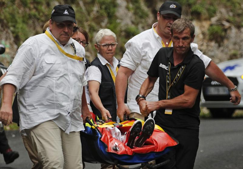 Australia's Richie Porte is carried to an ambulance after crashing in the descent of the Mont du Chat pass during the ninth stage of the Tour de France.