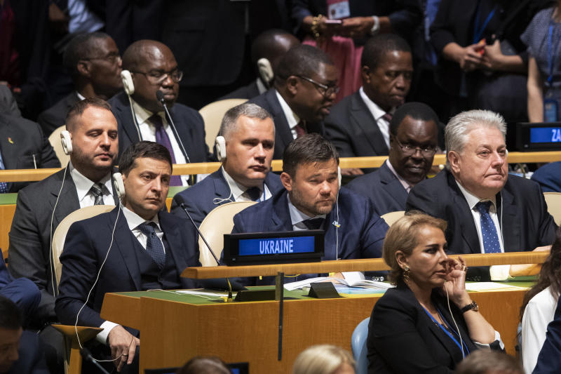 ADDS NAMES OF PRESIDENT ZELENSKY AND AMBASSADOR YELCHENKO - Delegates from Ukraine including President Volodymyr Zelensky, left, and Ambassador to U.N. Volodymyr Yelchenko, right, listen as U.S. President Donald Trump addresses the 74th session of the United Nations General Assembly at U.N. headquarters Tuesday, Sept. 24, 2019. (AP Photo/Mary Altaffer)
