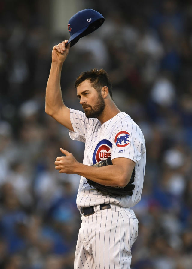 Chicago Cubs starting pitcher Cole Hamels tips his hat to the crowd after earning his 2,500 career strikeout during the third inning of a baseball game against the Chicago White Sox Tuesday, June 18, 2019, at Wrigley Field in Chicago. (AP Photo/Paul Beaty)