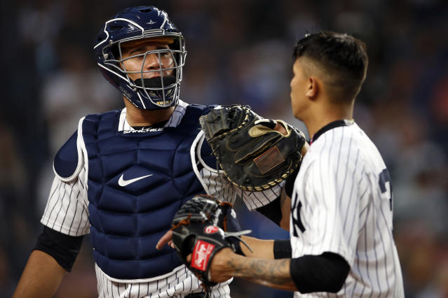 New York Yankees catcher Gary Sanchez congratulates pitcher Jonathan Loaisiga walking back to the dugout during the fifth inning of a baseball game against the Tampa Bay Rays, Friday, June 15, 2018, in New York. Loaisiga was making his major league debut. (AP Photo/Adam Hunger)