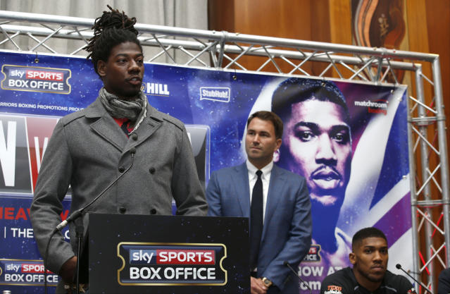 L-R: Boxer Charles Martin, Matchroom Boxing promoter Eddie Hearn, and boxer Anthony Joshua at a press conference in London on July 4, 2016, before Martin and Joshua fought for the IBF world heavyweight title. (Action Images via Reuters / Peter Cziborra Livepic)