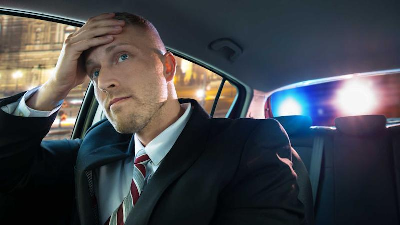 Stressed businessman pulled over by police