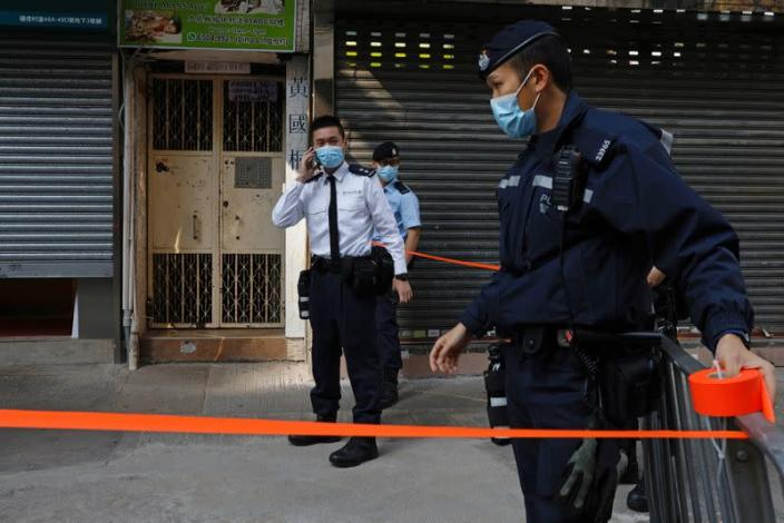 Police are seen outside the office of Daniel Wong Kwok-tung in Hong Kong
