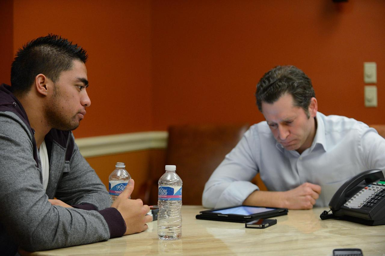"""In a photo provided by ESPN, Notre Dame linebacker Manti Te'o listens during an interview with ESPN's Jeremy Schaap, right, on Friday, Jan. 18, 2013, in Bradenton, Fla. ESPN says Te'o maintains he was never involved in creating the dead girlfriend hoax. He said in the off-camera interview: """"When they hear the facts they'll know. They'll know there is no way I could be a part of this."""" (AP Photo/ESPN Images, Ryan Jones) MANDATORY"""