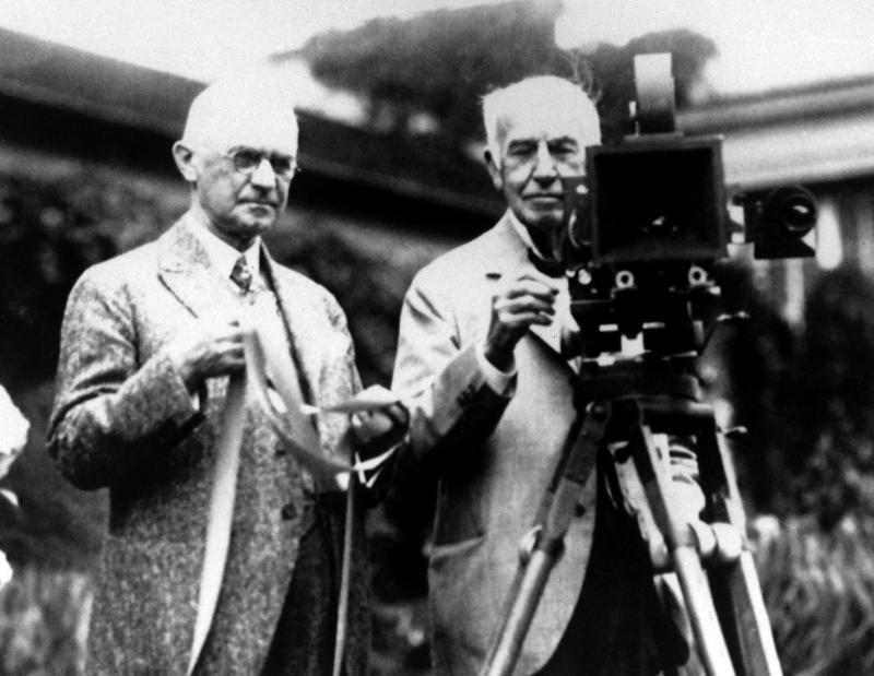 FILE - In this late 1020's file photo, Eastman Kodak Co. founder George Eastman, left, and Thomas Edison pose with their inventions in a photograph taken in the late 1920s.  Their contributions, Edison invented motion picture equipment and Kodak invented roll-film and the camera box, helped create the motion picture industry. Buffeted by fierce foreign competition, then blindsided by a digital revolution, photography icon Eastman Kodak Co. is teetering on a financial precipice after a quarter-century of failed efforts to find its focus. (AP Photo, File)