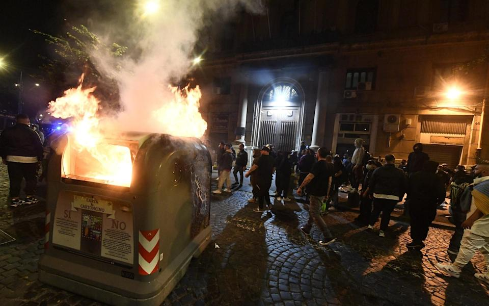 A garbage can set on fire in front of the Campania Region headquarters during the protest  - STRINGER/EPA-EFE/Shutterstock
