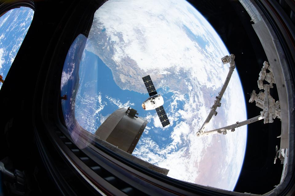 As SpaceX's Dragon CRS-19 cargo resupply ship arrives at the International Space Station, astronauts used the Canadarm2 robotic arm to reach out and grapple the incoming spacecraft. The Dragon, which arrived on Sunday (Dec. 8), carried more than 5,700 lbs. (2,585 kilograms) of supplies and science experiments for the crew of Expedition 61.