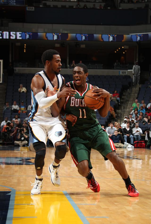 MEMPHIS, TN - OCTOBER 15: Brandon Knight #11 of the Milwaukee Bucks dribbles against Mike Conley #11 of the Memphis Grizzlies on October 15, 2013 at FedExForum in Memphis, Tennessee. (Photo by Joe Murphy/NBAE via Getty Images)