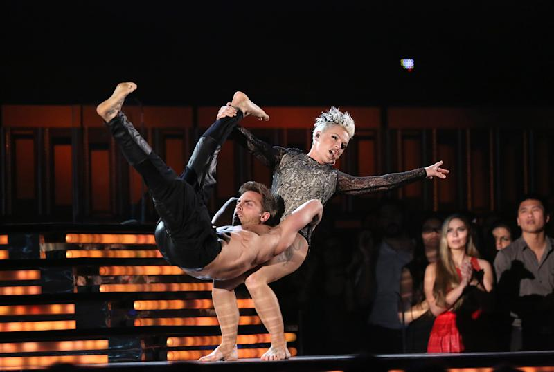 """Pink performs """"Just Give Me a Reason"""" on stage at the 56th annual Grammy Awards at Staples Center on Sunday, Jan. 26, 2014, in Los Angeles. (Photo by Matt Sayles/Invision/AP)"""