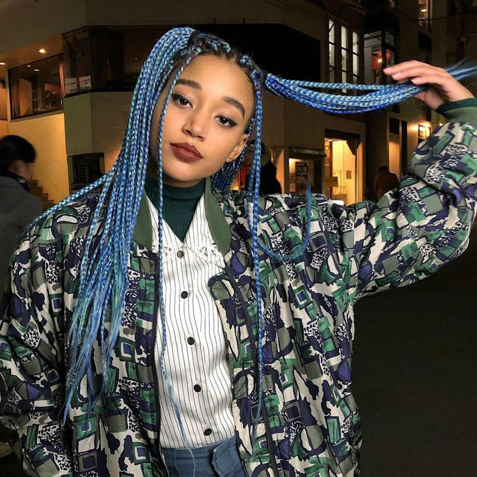 """""""Color is such a great way to give your box braids or faux locs a fresh look,"""" says Cassell. Add some extra edge by throwing two ponytails in with pieces left out at the front like Amandla Stenberg."""