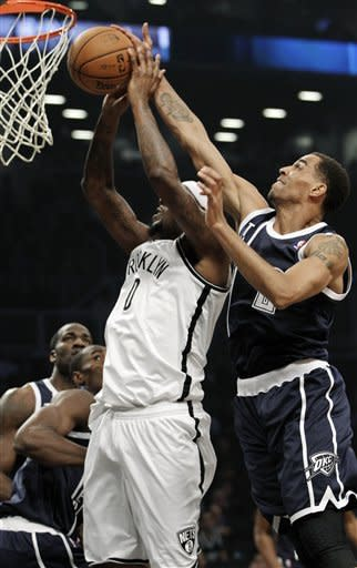 Oklahoma City Thunder guard Thabo Sefolosha, right, blocks a layup by Brooklyn Nets forward Andray Blatche (0) in the first half of their NBA basketball game at Barclays Center, Tuesday, Dec. 4, 2012, in New York. (AP Photo/Kathy Willens)