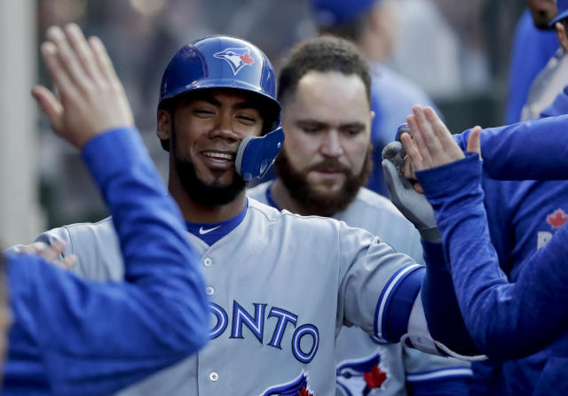 Toronto Blue Jays' Teoscar Hernandez celebrates in the dugout after his home run against the Los Angeles Angels during the third inning of a baseball game in Anaheim, Calif., Saturday, June 23, 2018. (AP Photo/Chris Carlson)