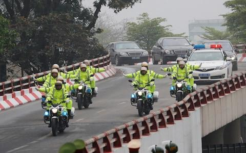 Vietnamese police ride ahead of the motorcade of North Korea's leader Kim Jong Un, enroute to his hotel ahead of the North Korea-U.S. summit in Hanoi