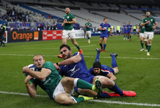 A penalty try is given to France after Ireland's Caelan Doris trips France's Francois Cros, on the ground at right during the Six Nations rugby union international match between France and Ireland in Paris, France, Saturday, Oct. 31, 2020. (AP Photo/Thibault Camus)