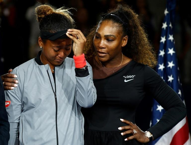 Naomi Osaka of Japan cries alongside runner-up Serena Williams after winning the 2018 US Open